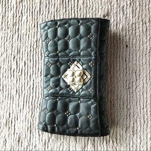 BCBG maxazria leather stud clutch